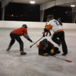 La Crosse broomball teams sponsored by Animal House and John's Bar play each other at the Copeland Park Oktoberfest Shelter in 2013. (Maureen McCollum/WPR)
