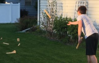 Chris Malina plays Swedish yard game kubb at his home in Fitchburg, Wisconsin.
