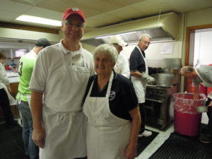 Dan Paulson and Jan Scholz at the Christ Lutheran Church lutefisk dinner in 2013.