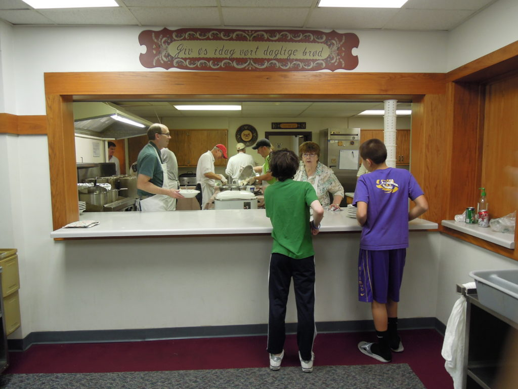 Volunteers work the lutefisk dinner at Christ Lutheran Church in 2013.