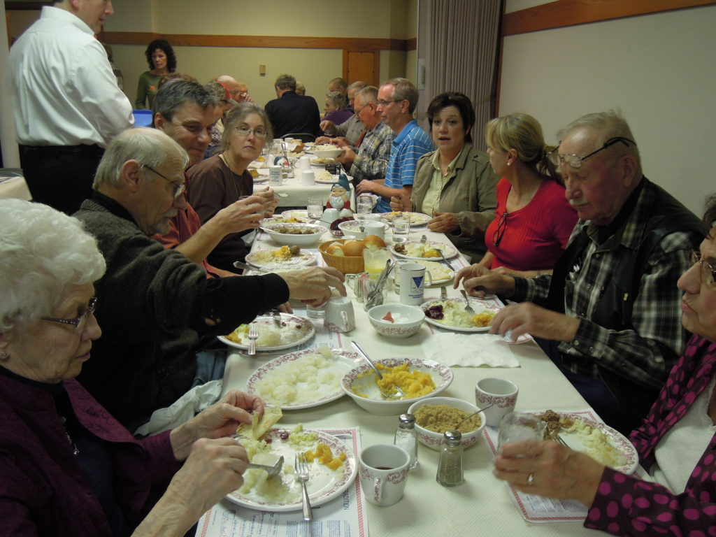 The Erlandson and Bunster families gather for the lutefisk dinner at Christ Lutheran Church in 2013.