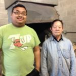 Apprentice Kong Mong Yang and master blacksmith Tong Khai Vang at the blacksmith shop at the Hmoob Cultural and Community Agency in La Crosse.