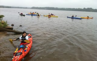 Yu Ting Fu gets into the Mississippi River backwaters to kayak with the rest of the crew.