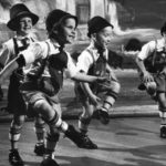 Group of boys in Bavarian costume performing a folk dance at the Bavarian Folk Festival in Milwaukee in 1963. (Credit: Wisconsin Historical Society.)