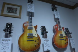 Two 1960 Gibson Les Pauls hang in Dave Rogers's personal collection at Dave's Guitar Shop.