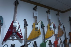 A 1959 Gibson Explorer hangs next to a 1991 reissue in Dave Roger's personal collection at Dave's Guitar Shop.