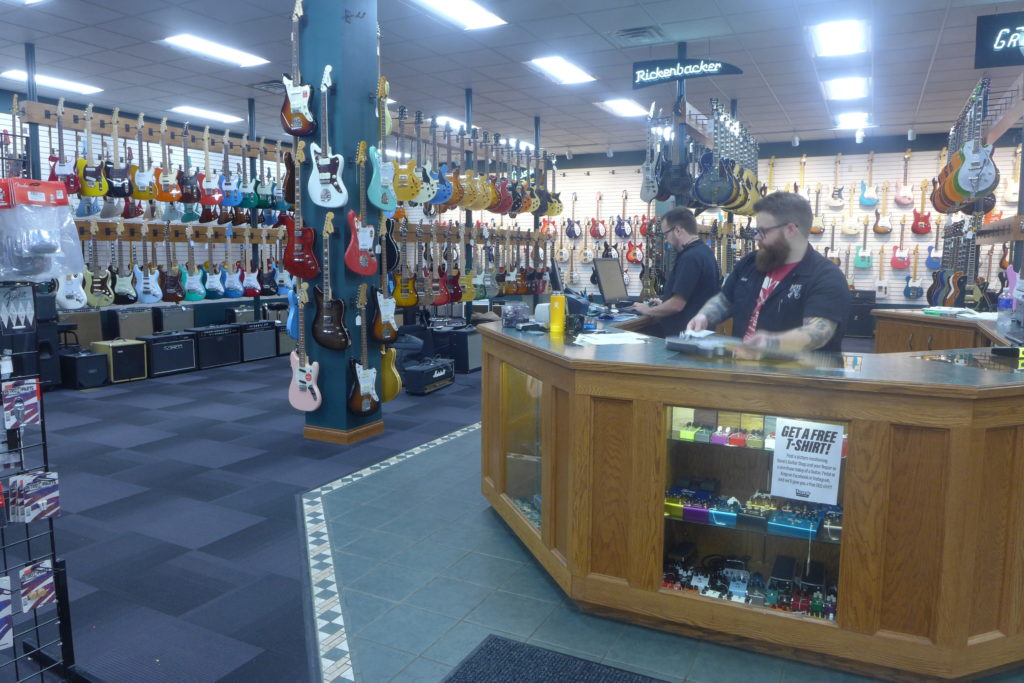 Employees at Dave's Guitar Shop.