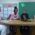 Chegwin Elementary School fourth grade teacher Pam Yanagihashi talks with her students Jakyla Smith, Nolen Henigan, and Sam Tynan