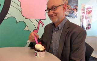 Author Dean Robbins enjoys an ice cream sundae.