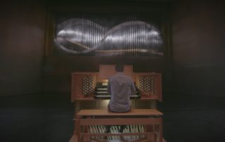Greg Zelek plays the organ