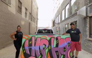Taylor Herrada and Charlie Herrada, of the H2 Collaborative, create an art piece for Hip-Hop Week.