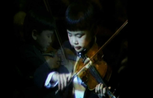 Eleven year-old Wayne Lin performs at the Weidner Center's debut performance in 1993.