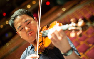 Wayne Lin plays the violin at the Weidner Center for the Performing Arts.
