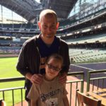 Brad Kolberg with his daughter at Miller Park.