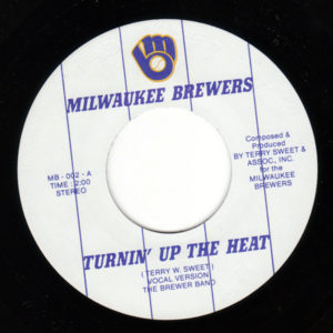 "45 rpm vinyl single of ""Turnin' Up The Heat."""