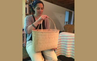 April Stone with one of her black ash baskets. (Photo by Tressa Versteeg)