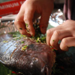 Stuffing herbs and spices into the whole fish