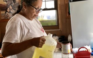 Katherine Denomie mixes the ingredients for frybread dough in her kitchen.