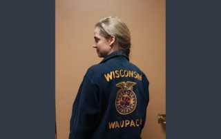 Author June Melby shows off her magical Waupaca FFA blue corduroy jacket. (Photo courtesy of June