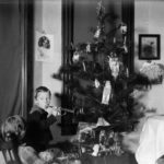 Cary and Everetta Bass with their Christmas tree in Montello, Wisconsin in 1902.