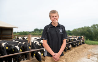 Fourteen year-old Drew Dettmann at Dettmann Dairy Farms in Johnson Creek, Wisconsin. (Photo by Max Cozzi for The Lands We Share)