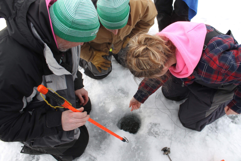 The day begins with setting the team's tip-ups. No experience is needed to join many of Wisconsin's ice fishing teams. Coaches can train new anglers how to compete. (Photo courtesy by Briley Hansen)