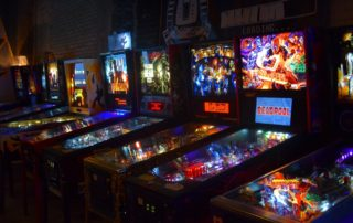 Pinball machines line a wall at Madison's newest arcade bar, I/O. (Jenny Peek/WPR)