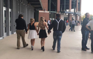 High school promgoers take photos at Lambeau Field. (Photo by Kelly Calaway)