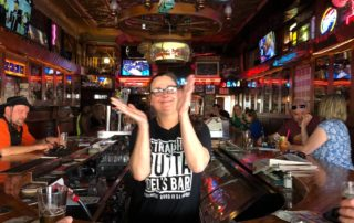 Sara Viner dances to the jukebox while working at Del's Bar in downtown La Crosse. (Maureen McCollum/WPR)