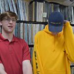 Matthew Schlaefer and Simon Terrill Collins in WPR's music library. (Maureen McCollum/WPR)