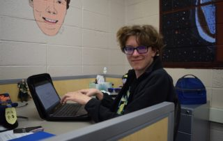 MG21 student Sam McNurlan works at his desk at school. (Maureen McCollum/WPR)