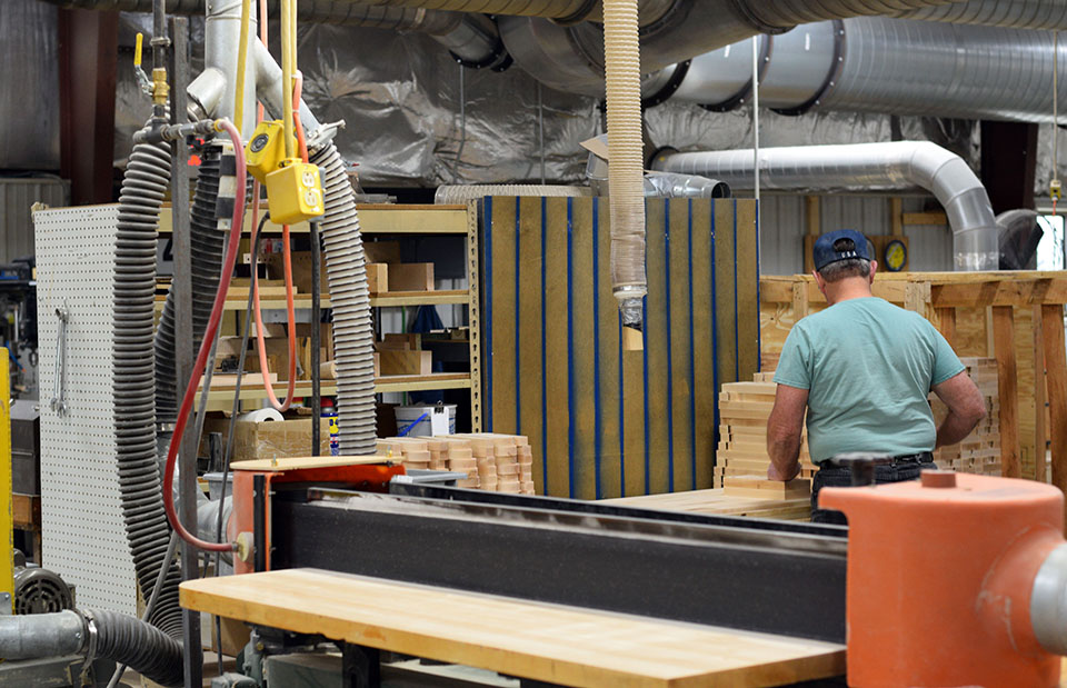 Workers shape and sand tap handles on the factory floor of AJS Tap Handles in Random Lake on Wednesday, Nov. 7, 2018. The company has been open since 1987 and claims to be the top producer of tap handles in the United States. (Andrea Anderson/WPR)