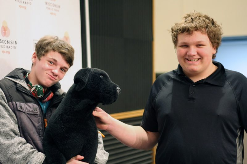 MG21 students Ashton Botts, left, and Preston Ivey with the WPR stuffed dog on a field trip to the station. (Jenny Peek/WPR)