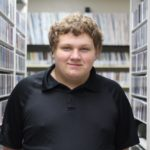 MG21 junior Preston Ivey in WPR's music library. (Jenny Peek/WPR)