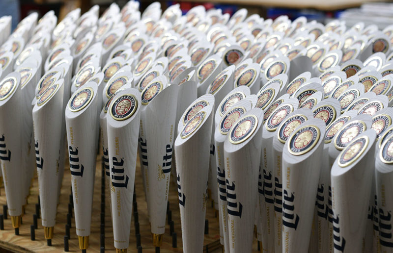 Finished Miller Lite handles sit in the detail room Wednesday, Nov. 7, 2018 at AJS Tap Handles in Random Lake after workers placed the finishing touches for the large order. (Andrea Anderson/WPR)