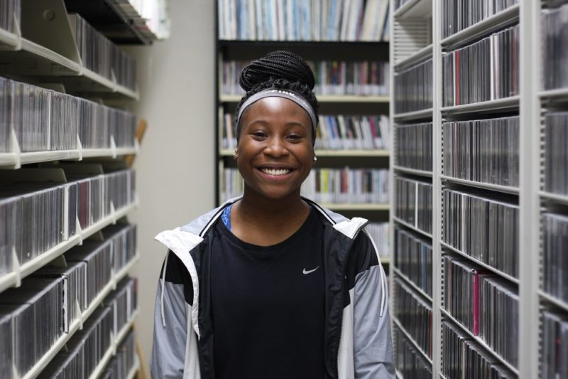 MG21 senior Jasnen Valencia is the WPR music library during a field trip. (Jenny Peek/WPR)