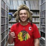 MG21 senior Luke Hennings in the WPR music library during a field trip. Not pictured, Noah Ebert. (Jenny Peek/WPR)