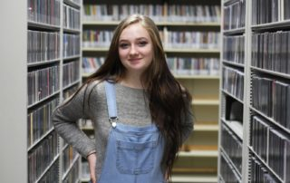 MG21 sophomore Coyote Johnson in the WPR music library during a field trip. (Jenny Peek/WPR)