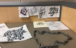 Some of the artwork and metalwork created by MG21 student Calvin Renard. (Maureen McCollum/WPR)