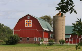 A Shawano County barn quilt is attached to a barn in the county. For the last nine years Jim and Irene Leuenberger have voluntarily painted the artwork in the basement of the Shawano Country Chamber of Commerce. (Photo by Jim Leuenberger)