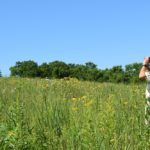 Rich Henderson on the Schurch-Thomson Prairie outside of Barneveld, Wisconsin. (Mary Kate McCoy/WPR)
