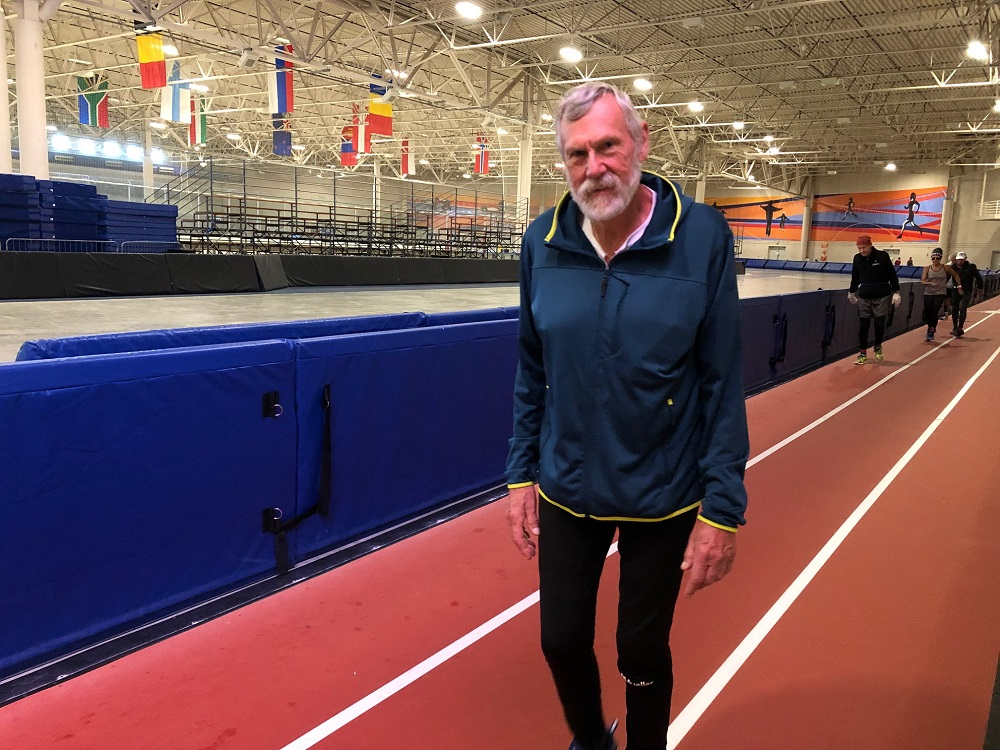 Cedarburg resident Jim Fiste ran nearly 256 miles during the Six Days in the Dome event at the Pettit National Ice Center in Milwaukee. (Corrinne Hess/WPR)