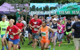 Stephen Strieker starts his Arbor Ridge Trail Race at the Robert O. Cook Memorial Arboretum outside Janesville, Wisconsin with a countdown and cowbell. (Photo by Kevin Sippy)