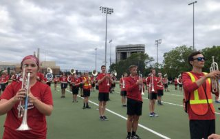 After a music and physical warm-up, the UW-Madison Marching Band rehearses the drill sets for their halftime show. (Tim Peterson/WPR)