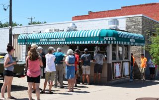 People waiting in line at Pete's Hamburger Stand. (Mary Kate McCoy/WPR)