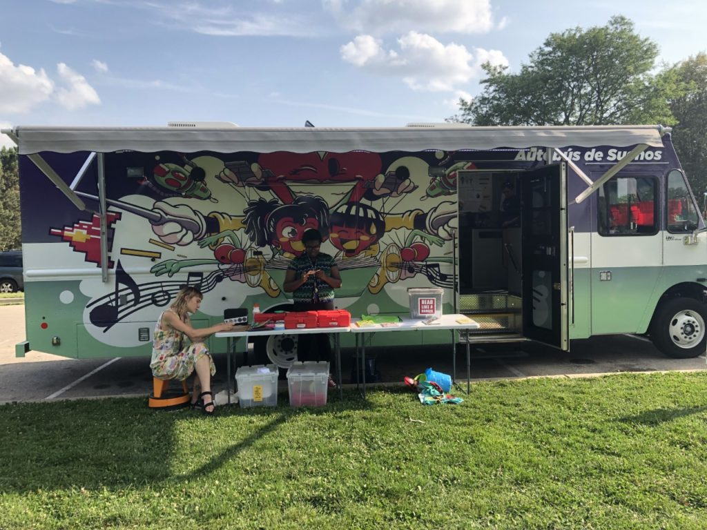 Madison Public Library's Dream Bus stops in different neighborhoods and brings books and media to people. (Jane Genske/WPR)