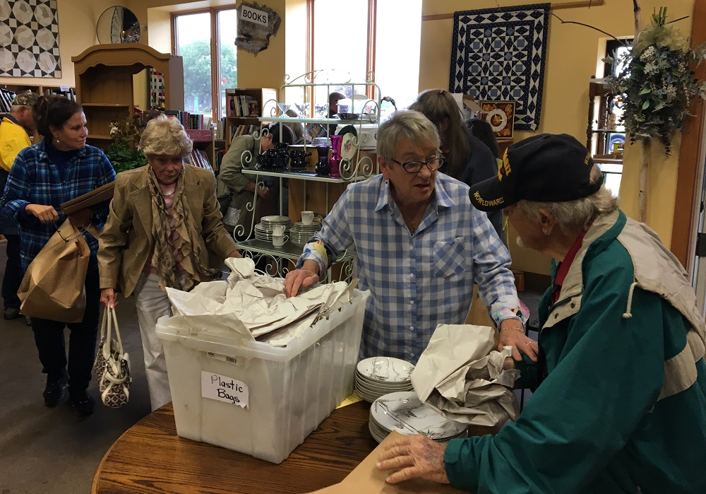 Store manager Jan Degner (in plaid shirt) helps customers. (Photo by Jane Hampton)
