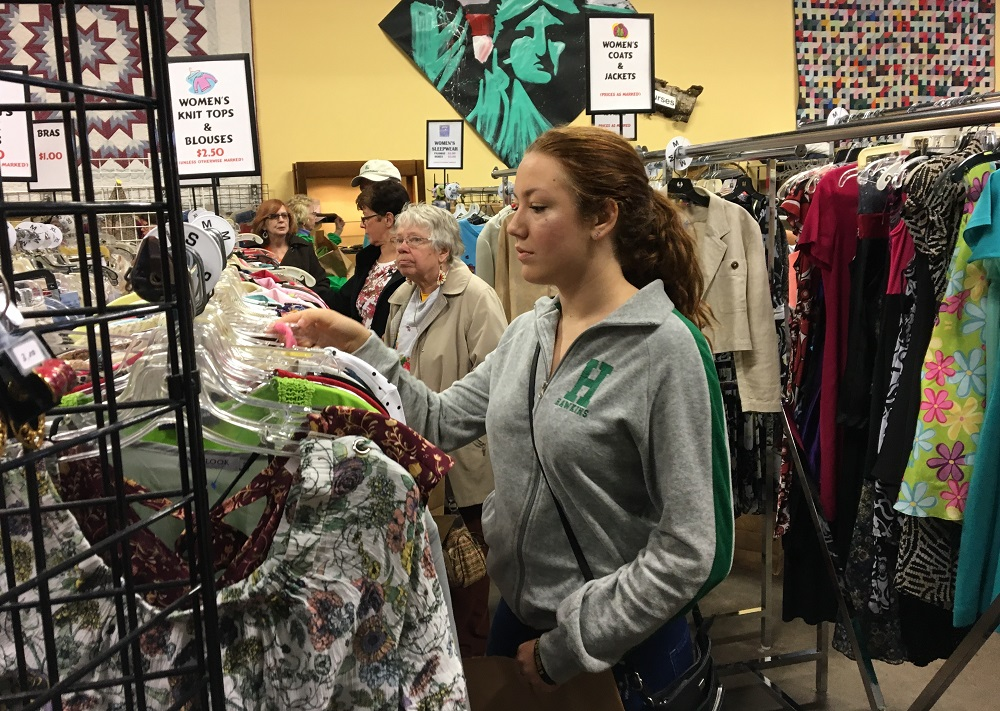 Shoppers look through clothes at St. Matthias' Thrift Shop. (Photo by Jane Hampden)