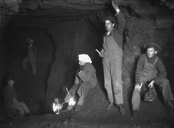 "Interior of a lead mine in Cassville, Wisconsin. The five miners are holding candles or lanterns. (Courtesy of <a href="" https://www.wisconsinhistory.org/Records/Image/IM93585/"" target=""_blank"" rel=""noopener noreferrer"">Wisconsin Historical Society</a>)"