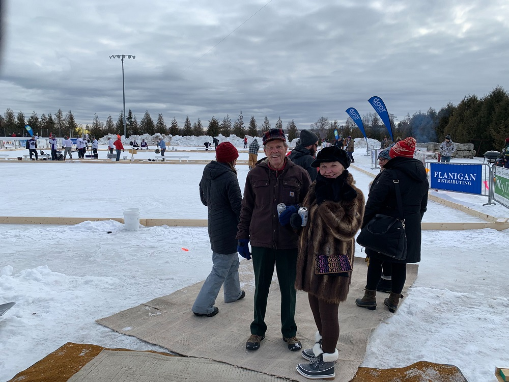 Bill and Kay Nelson live on Kangaroo Lake in Baileys Harbor. They said they were happy to be at this year's Door County Pond Hockey Tournament, even though it wasn't held on a pond. (Megan Hart/WPR)